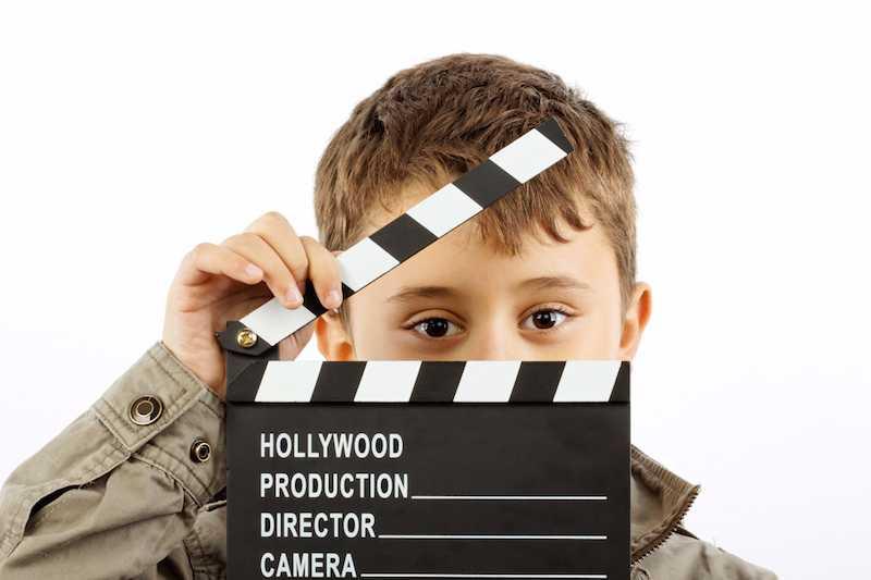 bigstock-Boy-With-Movie-Clapper-Board-10026356small-compressed